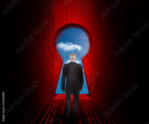 Doorway revealing cloudy sky with businessman standing