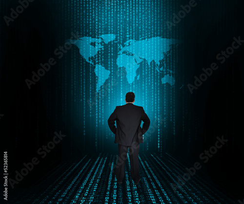 Businessman looking at large world map