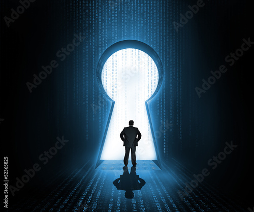 Businessman standing at the keyhole door showing light