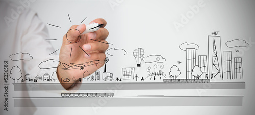 Businessman drawing a cityscape