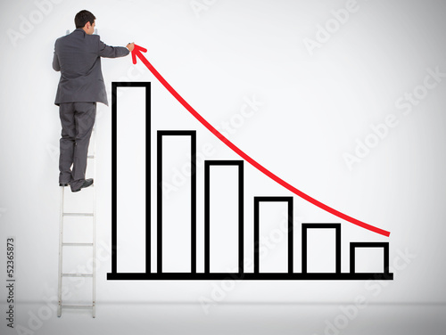 Businessman drawing red line above bar chart