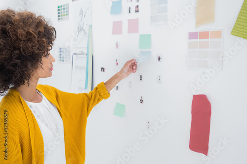 Designer standing in front of material samples