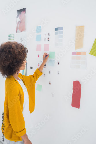 Female designer standing in front of material samples