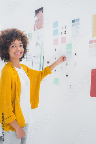 Attractive designer standing in front of material samples