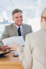 Businessman smiling at applicant