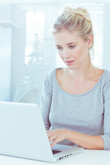 Attractive woman working on her laptop