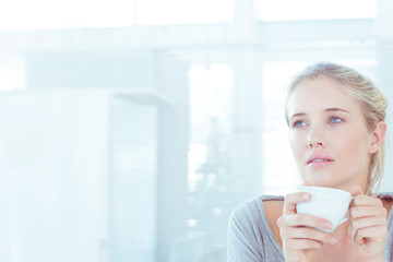 Relaxed attractive woman drinking a cup of tea