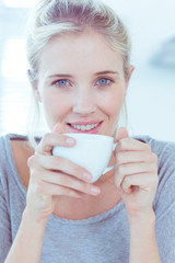 Smiling woman holding a cup of tea