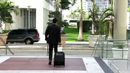 Young city businessman with travel luggage