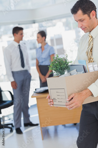 Businessman leaving office after being laid off