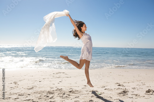 Woman with sarong jumping