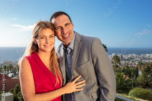 Couple gesturing on the balcony