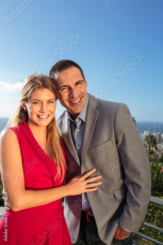 Delighted couple gesturing in front of the camera