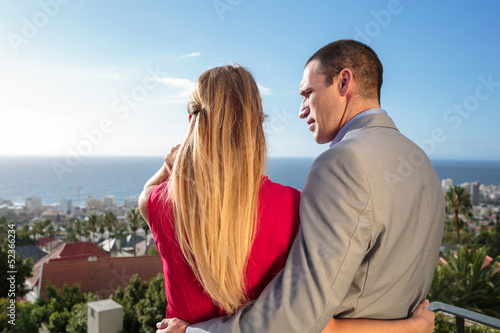 Rear view of a couple on balcony