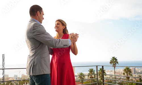 Couple dancing together on the balcony