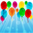 balloons of different color on a background blue sky
