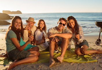 Friends having a barbecue party on the beach