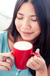 Attractive asian woman drinking coffee
