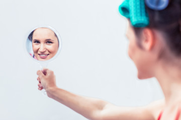 Young woman holding a mirror