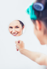 Beautiful woman holding a mirror
