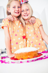 Cute twins celebrating their brithday