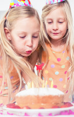 Little girl blowing her candles