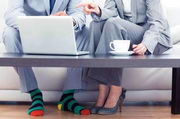 Business people sitting on a couch