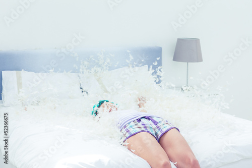 Attractive woman falling on her bed