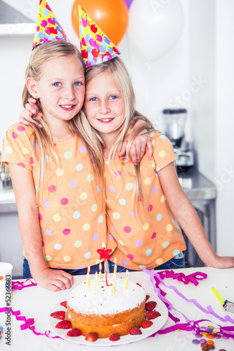 Twins looking at the camera on a birthday