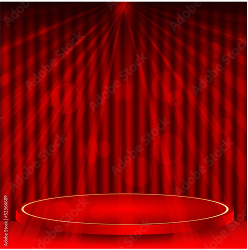 podium on a background a red curtain and rays of light