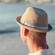 Relaxed man with a hat on the beach