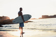 Handsome man holding surfboard