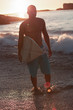 Silhouette of a man holding a surfboard