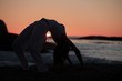Silhouette of a woman doing crab yoga pose
