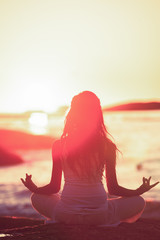 Silhouette of woman meditating