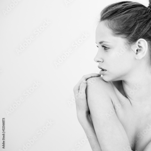 Beautiful young woman topless in black and white
