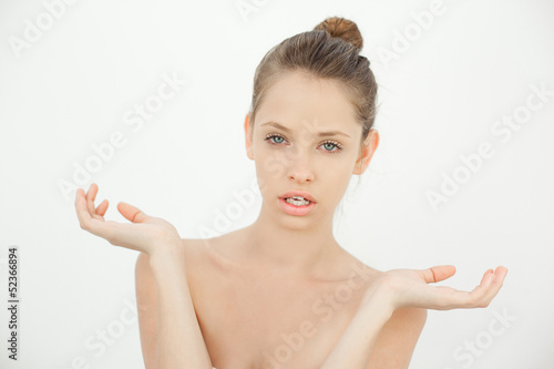 Attractive topless woman gesturing