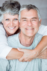 Cheerful mature woman embracing her husband
