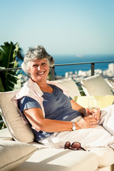 Cheerful mature woman relaxing outdoors