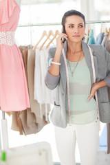 Pretty fashion designer on the phone