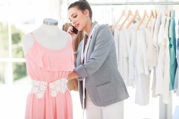 Attractive fashion designer on the phone