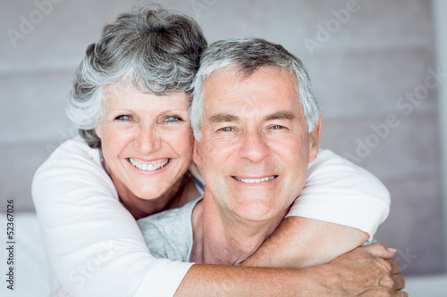 Mature woman embracing her husband
