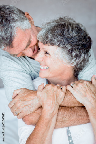 Mature man embracing his wife