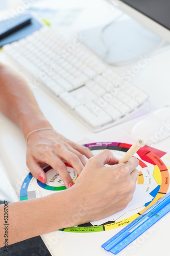 Designer working with a colour wheel