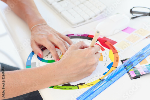 Designer working on a colour wheel