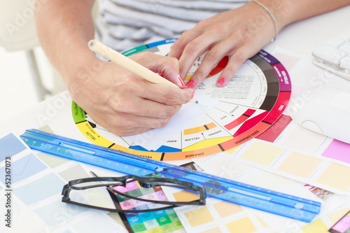 Female designer working on a colour wheel