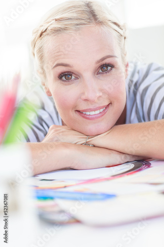 Pretty designer posing on her desk