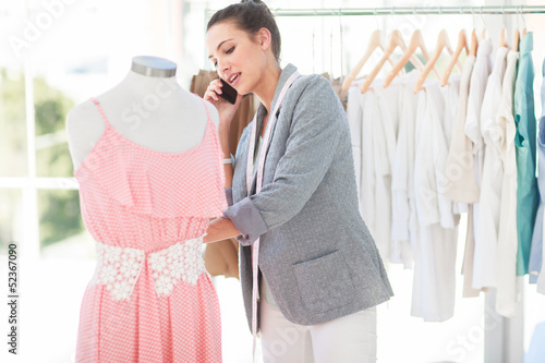 Attractive fashion designer on the phone