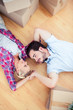 Young couple relaxing on the wooden floor