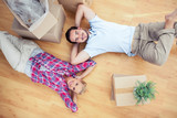 Pretty couple lying on the wooden floor